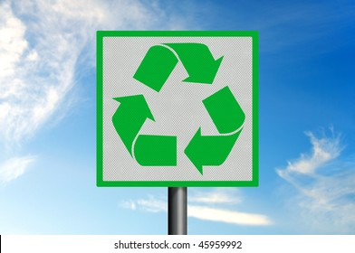 Photo realistic metallic reflective road sign, depicting the green and white recycling logo, against a blue sky.