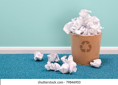 Photo of a recycling waste paper basket on an office floor
