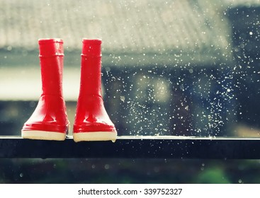 Photo of red boots under rain