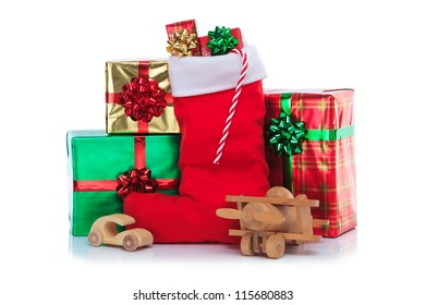 Photo of a red Christmas stocking with gift wrapped presents and toys, isolated on a white background.