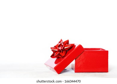 Photo of red gift box on white background