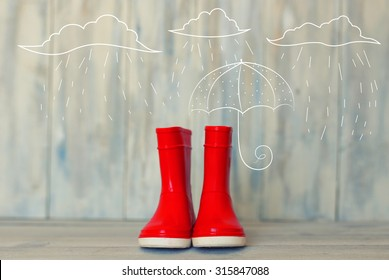 Photo of red rain boots