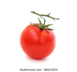 Photo of red tomato on a branch