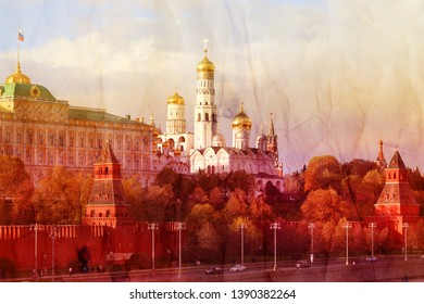Photo of the red tower of the Moscow Kremlin and church against the background of the spring sky