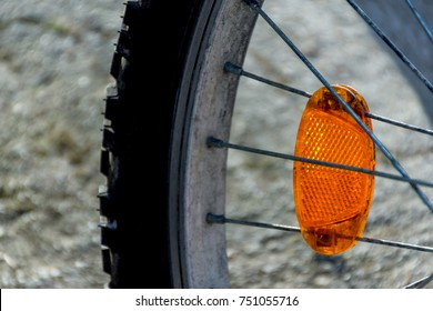 Photo of a reflector light on a bicycle wheel