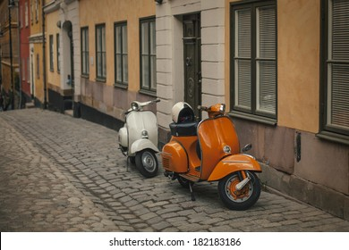 Photo retro scooters in the old town of Stockholm. Effect retro film