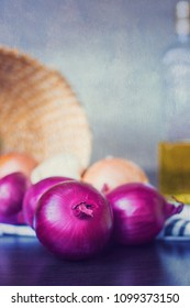Photo of ripe onions with oil in the background and teyture applied on the photo
