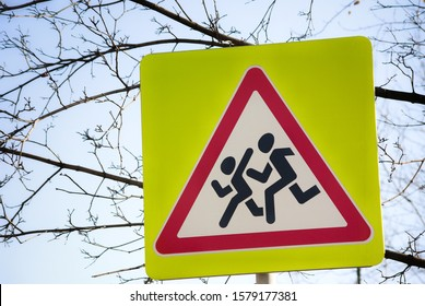 Photo of a road sign running over children