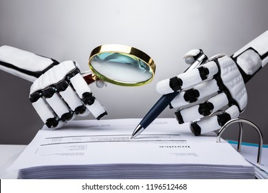 Photo Of Robot Examining Invoice With Magnifying Glass