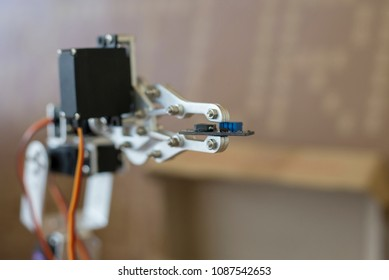 Photo of robot manipulator, which holds the little chip