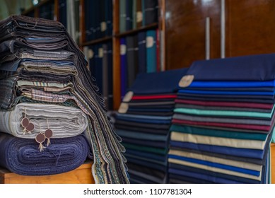 Photo of Rolls of textiles in a fabric shop. Multi colors and patterns.