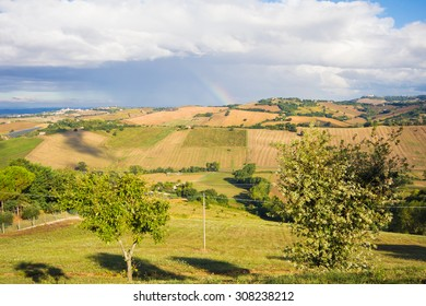 Photo of rural land with rainbow