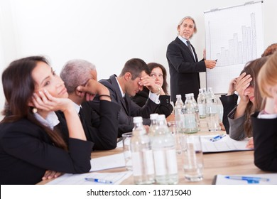 Photo Of Sad Business Team Attending The Seminar