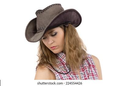 Photo of sad cowgirl on white background