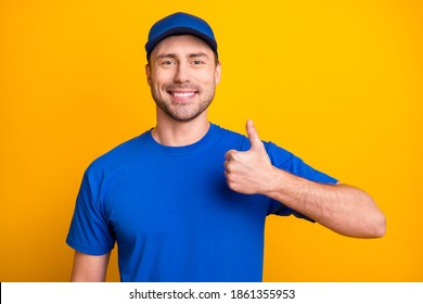 Photo of satisfied person toothy smile show thumb up wear blue cap isolated on vibrant yellow color background