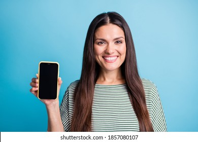 Photo of satisfied woman hand hold phone screen empty space wear white green isolate don blue color background