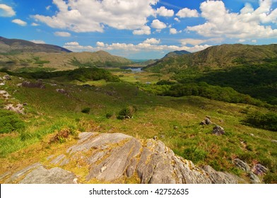 photo of a scenic landscape with lake and mountains