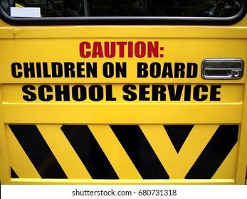 Photo of a school bus door with sign