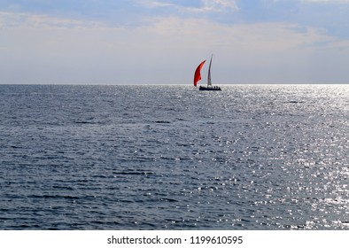 Photo of the sea bright beautiful landscape with waves and a boat lit by the sun