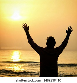 A photo at sea on sunshine and a man is praying to god early in the morning ut looks fantastic when I clicked this will be very useful for devotional background and quotations and much more