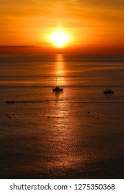 Photo of sea sunset with a boat in the autumn evening