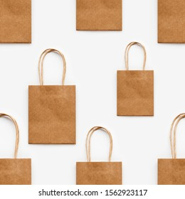 Photo seamless pattern with craft paper shopping bags. Zero waste lifestyle. Copy space.