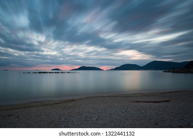 photo of seascape with dramatic light made from the Venere Azzurra beach with Porto Venere in the background