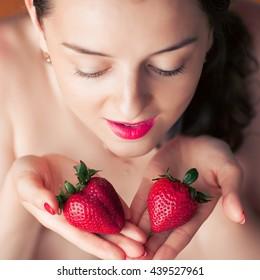 Photo of seductive female eating strawberry, close up portrait of sensual woman biting juicy fruit , fruity diet, tasty dessert, Valentine day, pleasure concept