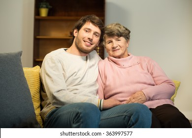Photo of senior lady and her young male carer