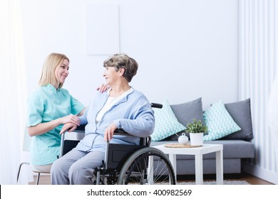 Photo of senior lady on wheelchair and her caregiver