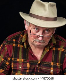 photo of senior male with sad or grumpy face portrait