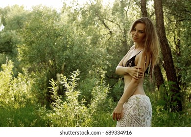 Photo session of a girl in the forest