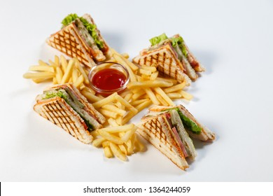 Photo session new menu of coffee house, fresh club sandwich with chicken and vegetables, lettuce salad, french fries and ketchup isolated on white background. Concept unhealthy street fast food