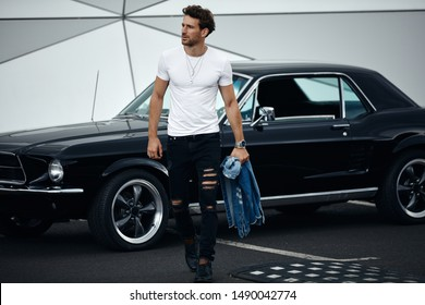 Photo of sexy young man with black classic car
