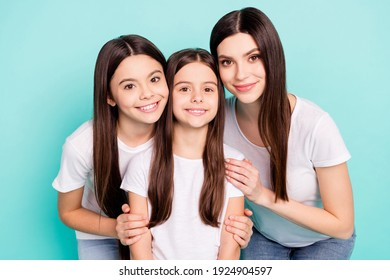 Photo of shiny adorable three sisters dressed white outfit smiling hugging isolated turquoise color background