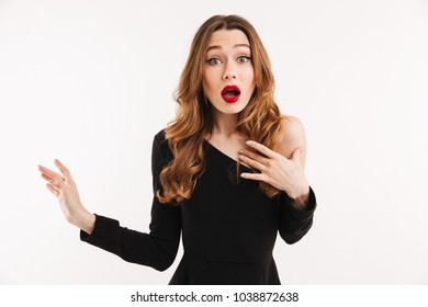Photo of shocked young woman isolated over white background. Looking camera.