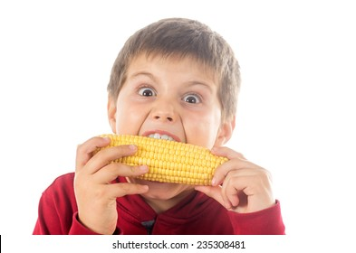 photo shoot of a child eating a corn cob with a white background