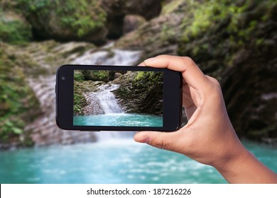 photo shooting on smartphone in tourist journey