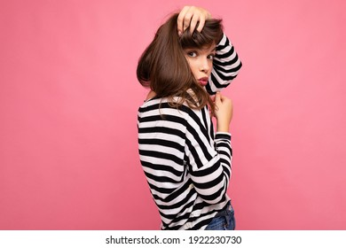 Photo shot of cute attractive pretty young brunette woman wearing casual striped longsleeve isolated over colorful background with copy space