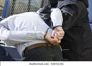 The photo shows the arrest of a man.