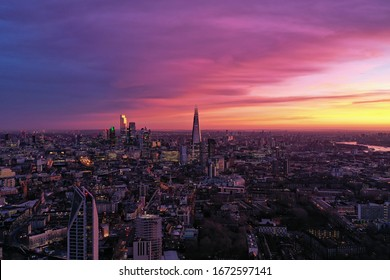 Photo shows beautiful sunrise at London where the sky is in pink and violet color.