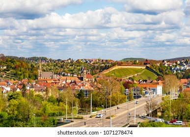 The photo shows Esslingen at the Neckar in Germany with the old fortress in the background