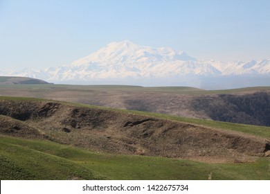 The photo shows the nature of the Caucasus - Small Karachay. Mount Elbrus is the highest point in Europe. Sky mountains