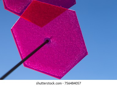 The photo shows a sun catcher photographed in reverse light