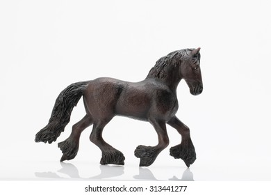Photo shows the toy horse on white.
