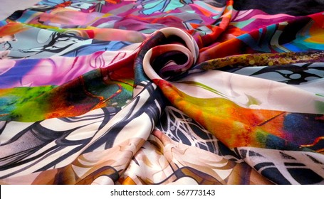 Photo silk fabric. Silk scarf with bright abstract print. Textile Design. Painting fabric, silk painting in batik