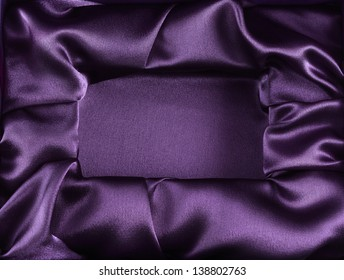 Photo of silk opened box as texture background top view