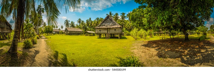 Photo of simple house made of straw and bamboo surrounded by greenery in Avatip, Sepik river in Papua New Guinea. In this region, one can only meet people from isolated local tribes.