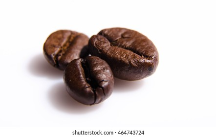 Photo of a single coffee grain isolated on a white background