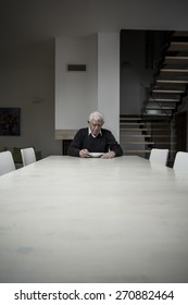 Photo of single older man eating dinner alone at home